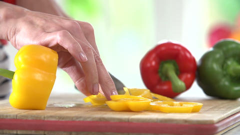 Close Up Of Woman Chopping Peppers On Wooden Board Footage