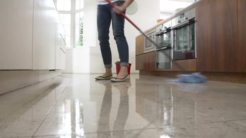 Time Lapse Sequence Of Woman Mopping Kitchen Floor Footage