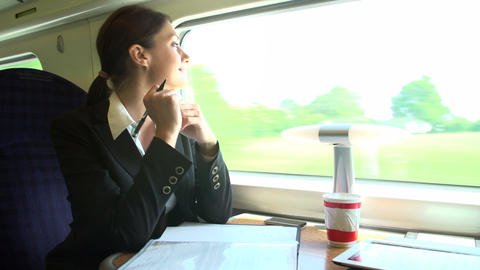 Female Commuter With Coffee On Train Working On Do Footage
