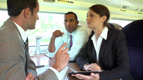 Group Of Businesspeople Having Meeting On Train Footage