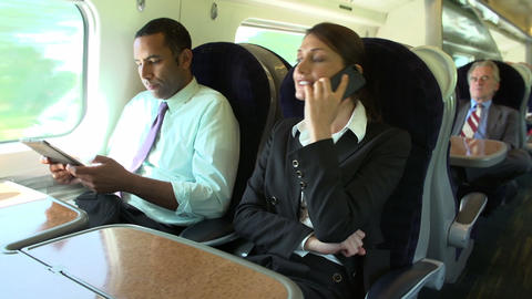Businesspeople On Train Using Digital Devices Footage