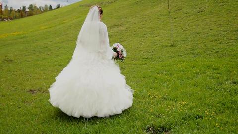 bride walks around the hill Footage