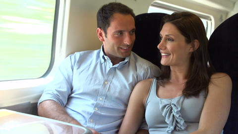 Couple Relaxing On Train Journey Together stock footage