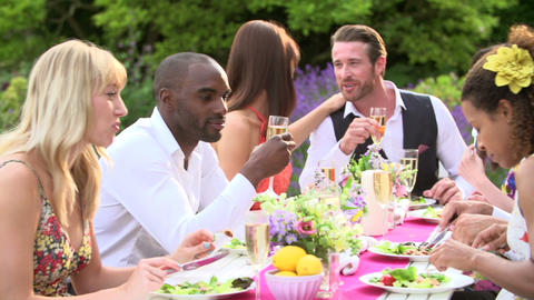 Friends Enjoying Outdoor Dinner Party Together Footage