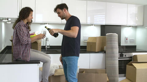 Couple Celebrating Moving Into New Home With Champ Footage