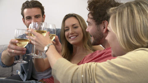 Group Of Friends Enjoying Glass Of Wine At Home Footage