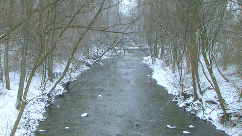 Creek with Snow Falling Stock Video Footage