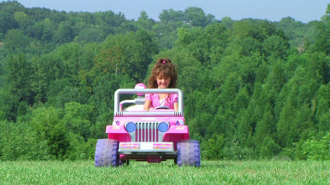 Girl Driving Toy Jeep Stock Video Footage