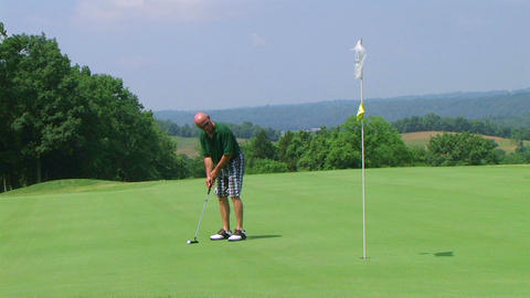Golfer Sinks Putt Stock Video Footage