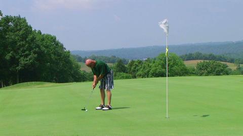 Golfer Sinks Putt Stock Video Footage