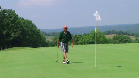 Golfer Sinks Putt Footage