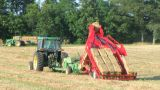 Farmer Square Baling Hay stock footage