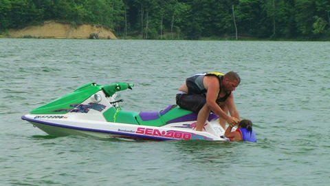 Daughter Boarding Jet Ski Stock Video Footage