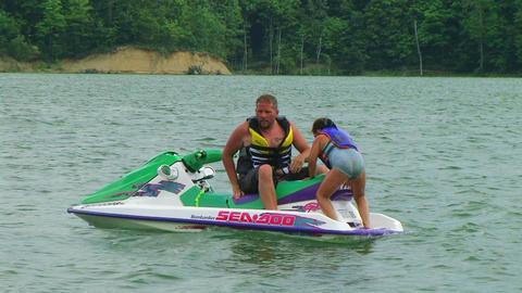 Daughter Boarding Jet Ski Stock Video Footage