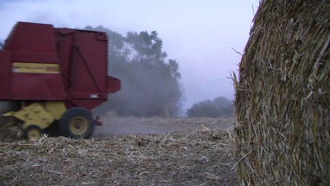 Farmer Round Baling Hay Stock Video Footage