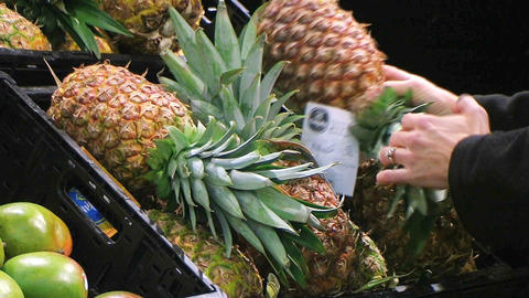 Woman Selects Pineapple Stock Video Footage
