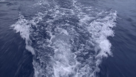 slowmo water swirl behind a boat Footage