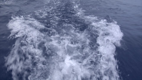 slowmo water swirl behind a boat Stock Video Footage