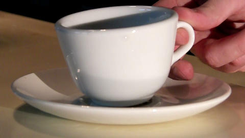 put a cup on a saucer Stock Video Footage