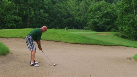 Golfer Uses Wedge In Bunker Stock Video Footage