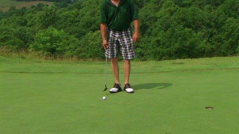 Golfer Sinks Putt 04 Footage