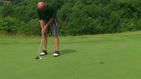 Golfer Sinks Putt 04 Stock Video Footage