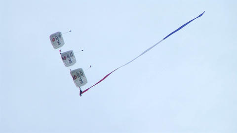 Skydivers Parachuting In Formation Stock Video Footage
