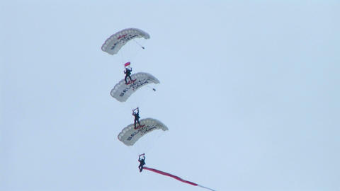 Skydivers Parachuting In Formation Footage