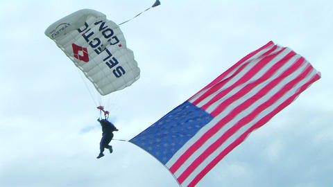 Skydiver Parachuting With Flag Footage