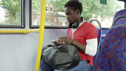 Passenger Leaving Mobile Phone On Seat Of Bus stock footage