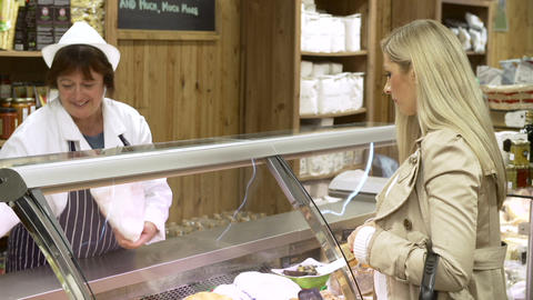 Female Sales Assistant Serving Customer In Delicat Footage