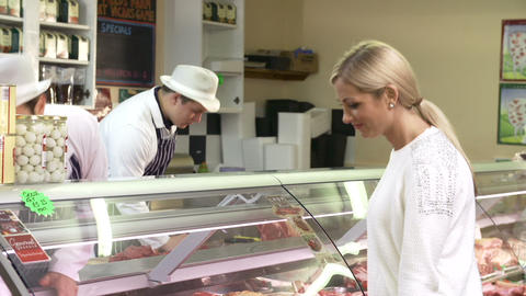 Butchers Serving Customers In Shop Footage