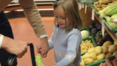 Family Choosing Fresh Vegetables In Farm Shop Footage