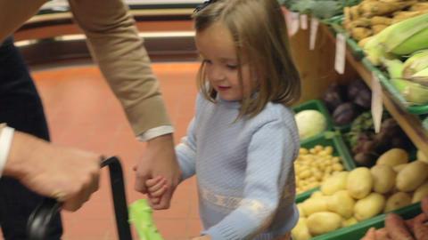 Family Choosing Fresh Vegetables In Farm Shop Footage