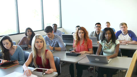University Students Using Digital Tablet And Lapto stock footage