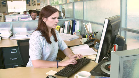 Woman Working At Computer In Modern Office Footage