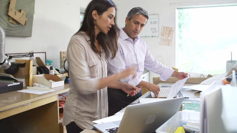 Two Architects Working With Plans In Office Togeth Footage