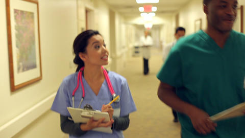 Medical Staff Working At Busy Nurses Station Footage