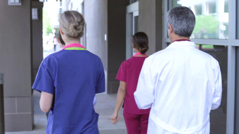 Medical Team Having Discussion As They Walk Into H Footage