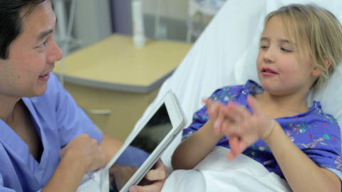 Young Girl Talking To Male Nurse In Intensive Care Footage