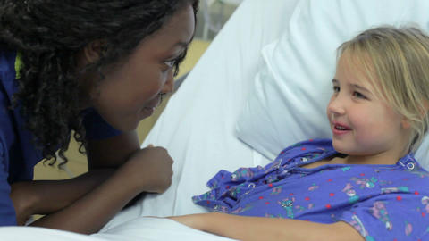 Young Girl Talking To Female Nurse In Intensive Ca Footage