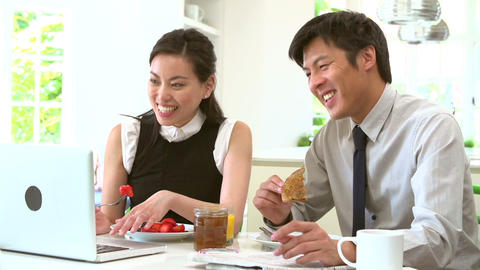Asian Couple With Laptop And Newspaper At Breakfas Footage