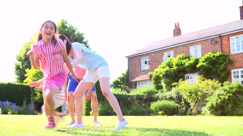 Asian Family Playing In Summer Garden Together Live Action