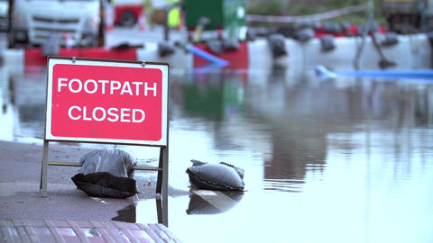 Sign Warning Of Footpath Closure Due To Flooding stock footage