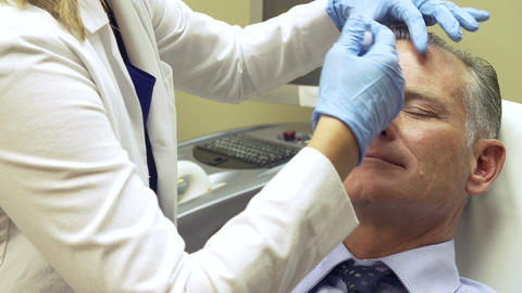 Man Having Botox Treatment At Beauty Clinic Footage