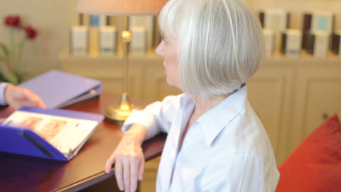 Senior Woman Talking To Financial Advisor In Offic stock footage