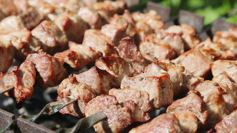 Shashlyk (kebab) grilling on the bbq, closeup view Footage