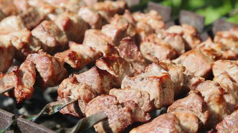 Shashlyk (kebab) grilling on the bbq, closeup view Footage