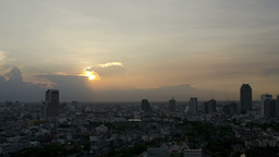 Sun Setting Behind Storm Clouds in Bangkok - 4k Footage
