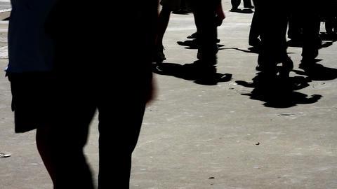 People Silhouettes Against Sidewalk Footage